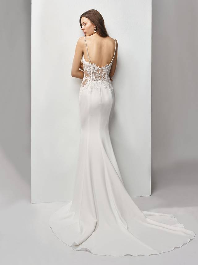 Code: Enzoani Beautiful BT19-02 Sleek mermaid style with modern side cutouts sweetly covered in embroidered lace. This sweetheart neckline and figure-hugging stretch georgette gown continues its sweet appeal with an illusion back and delicate covered buttons.Colour Option : Ivory/Nude  OR  Ivory/Ivory