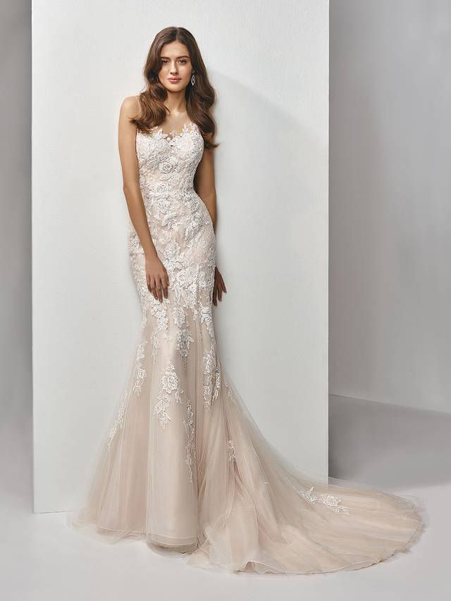 Code: Enzoani Beautiful BT19-14 Sweet, elegant, romantic. This full-length mermaid gown features delicately beaded, embroidered and chantilly lace laid out on the softest tulle for a dreamy effect complemented by the illlusion bateau sweetheart neckline. A low illusion back with covered buttons adds a striking finishing touch.Colour Options : Ivory/Latte  OR  Ivory/Ivory