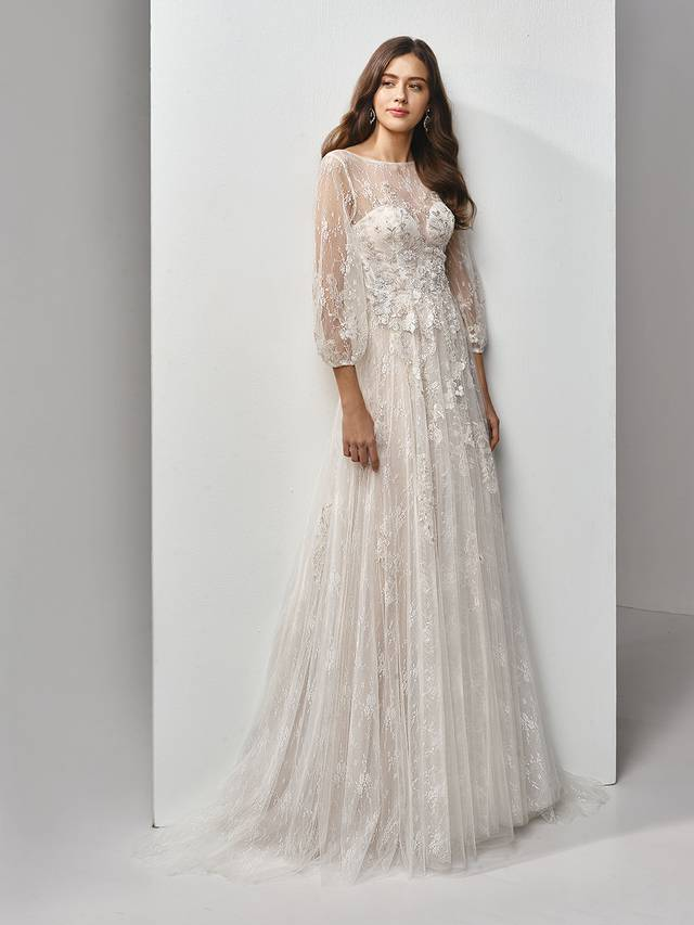 Code: Enzoani Beautiful BT19-18 Talk about timeless. This full-length, A-line gown is classically gorgeous at every turn, with long lace and tulle bell sleeves for the perfect bohemian fairytale look. An illusion scoop over deep sweetheart neckline adds some modern sexiness, while embroidered lace and chantilly lace sprinkling down to the soft tulle skirt provides all the intricate detailing that will have your guests ooh-ing and aah-ing. The gorgeous low, open V-back is finished with covered buttons and an invisible zipper closure.Colour Options : Ivory/Pewter/Nude  OR  Ivory/Pewter/Ivory