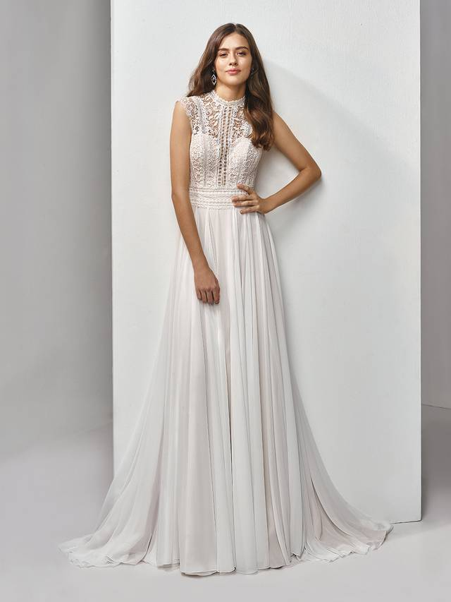 Code: Enzoani Beautiful BT19-19 Feminine and romantic with vintage vibes and a boho feel -- this full-length, A-line gown features a striking bodice with exquisite eyelet lace with sweet floral motifs. A deep sweetheart neckline adds some modern sexiness to balance out the slightly high neck and cap sleeves. Light chiffon is a soft, dreamy complement to the bodice and matching illusion eyelet lace back with covered buttons and invisible zipper closure.Colour Options : Ivory/Latte  OR  Ivory/Ivory