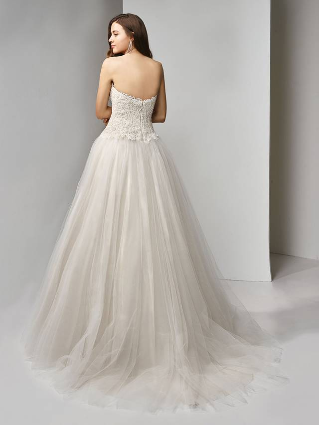 Code: Enzoani Beautiful BT19-21 Bring out your inner princess in this full A-line ball gown fit for a fairytale. A deep strapless sweetheart neckline provides plenty of allure as the beaded, embroidered lace bodice captures the eye and complements the voluminous, dreamy tulle skirt. The lovely look is finished with an invisible back zipper closure.Colour Options : Ivory/Beige  OR  Ivory/Ivory
