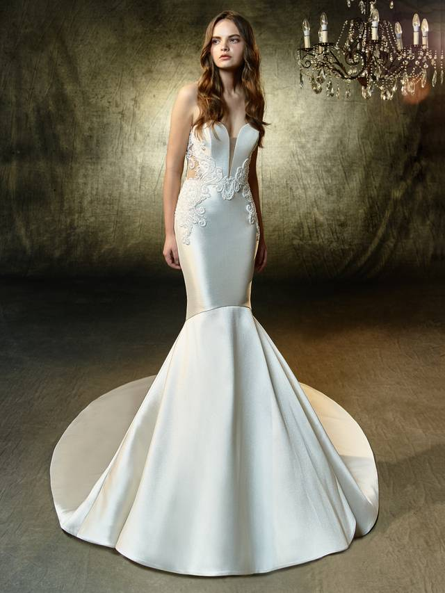 Code: Enzoani Blue Laken An impeccably gorgeous mermaid gown constructed with mikado fabric. A sleek, strapless sweetheart illusion neckline and striking illusion back is embellished with beaded, embroidered lace to create a feminine allure.Colour Options : Ivory/Nude  OR  Ivory/Ivory