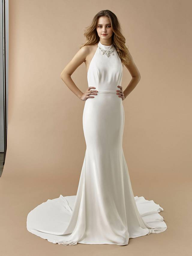 Code: Enzoani Beautiful BT20-12 For the modern bride searching for effortless elegance, this ultra-comfy stretch georgette mermaid gown is the answer. BT20-12 features a sophisticated halter neckline with exquisite beading for the perfect hint of sparkle. It's open, plunging V-back is complete with covered buttons and an invisible zipper closure.Colour Options: Ivory