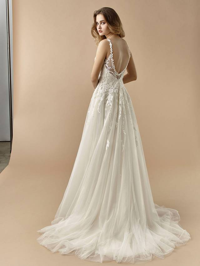 Code: Enzoani Beautiful BT20-15 Effortless and romantic, this A-line gown hugs at just the right spot on the hips to flatter the figure and show off that gorgeous waist. A sweet and sultry low V-back finishes the look.Colour Options: Ivory