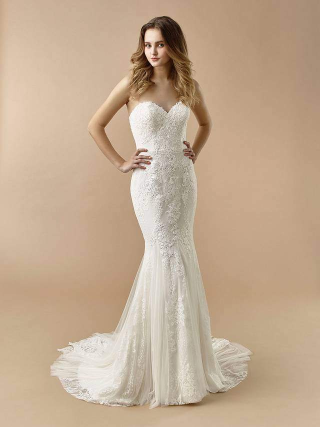 Code: Enzoani Beautiful BT20-17 This gorgeous mermaid gown features a sweetheart neckline bodice with built-in corset to flatter and highlight your figure. Sweet lace is sprinkled throughout the gown and down the dreamy tulle skirt for effortless romance.Colour Options: Ivory/Latte  OR  Ivory/Ivory