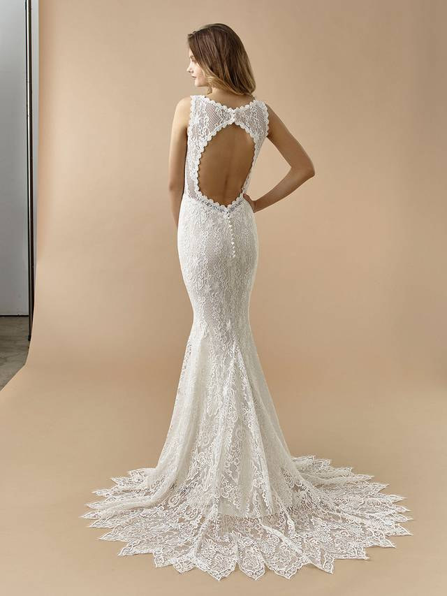 Code: Enzoani Beautiful BT20-22 Playful, whimsical and chic, this mermaid gown features a high illusion neckline to highlight gorgeous vintage overlace. A modern twist is added with its edgy keyhole back, finished with covered buttons and an invisible zipper.Colour Options: Ivory/Latte  OR  Ivory/Beige  OR  Ivory/Ivory