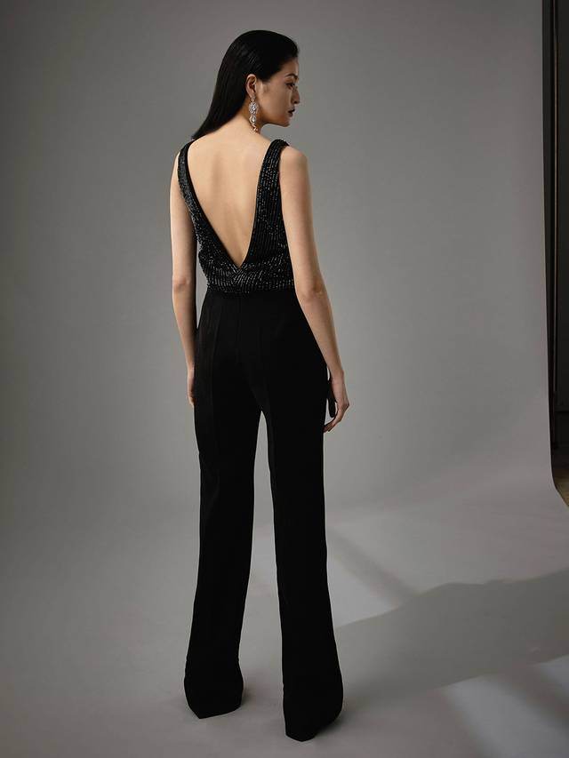 Code: Enzoani Blue - Marisabel Edgy and chic, this is meant for the modern bride. Complete with the most exquisite beadwork at the bodice, Marisabel is sure to dazzle your guests. A low, open back adds an element of cheekiness. Move with ease and mobility as this jumpsuit finishes with sleek, pocketed trousers and an invisible zipper.Colour Options: Ivory  OR  Black