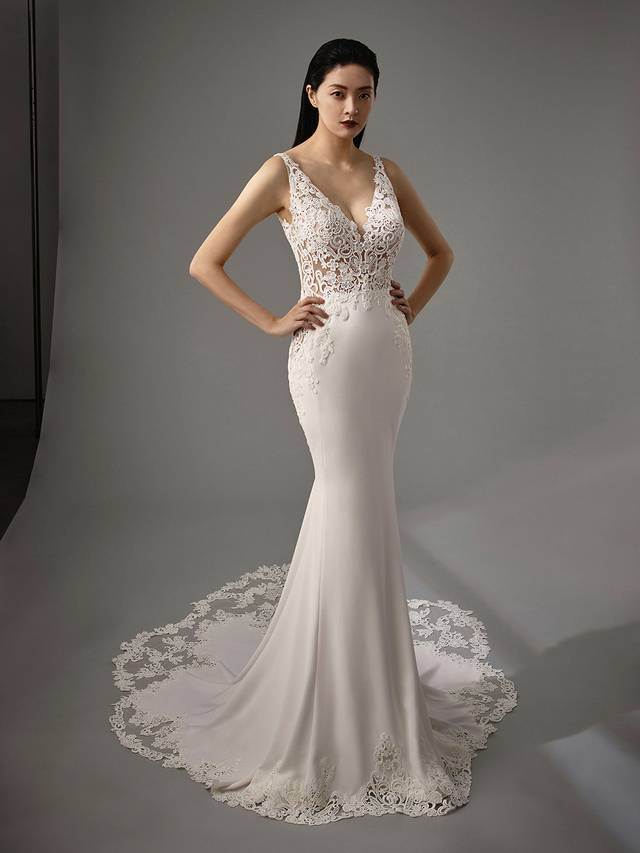 Code: Enzoani Blue - Mimi Sweet and elegant, the classic combination of beautifully crafted lace and soft stretch georgette meet again in this gorgeous mermaid gown. A low V-back and cascading covered buttons provide a romantic touch and clean finish.Colour Options: Ivory/Nude  OR  Ivory/Ivory