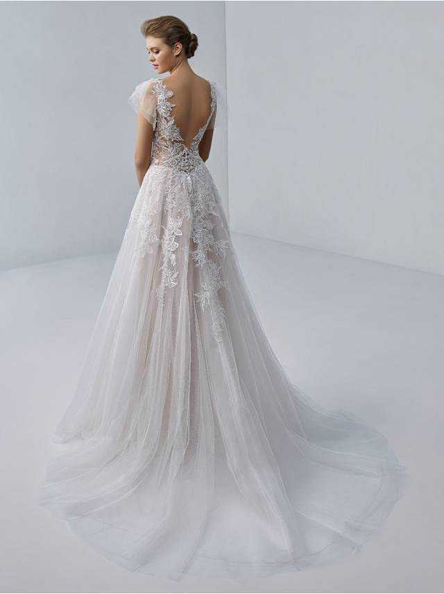 Code: Etoile Aimee - IN STUDIO Romantic and ethereal, this gown features flirty shoulder tulle detailing, a plunging illusion neckline, and exquisite floral embroidered lace atop soft organza and tulle.Colour Options: Ivory/Nude/Nude  OR   Ivory/Ivory/Nude